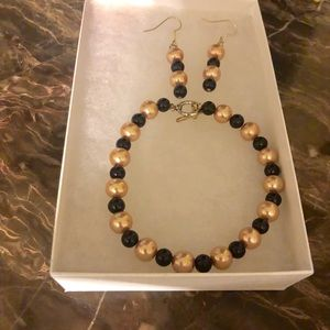 Black and gold pearl bracelet and earrings